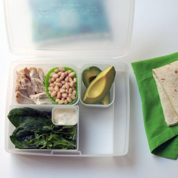 Portion Perfect Lunchtime Wrap made using the infographic, chicken, beans, avocado, spinach, arugula, dressing