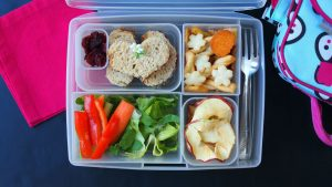 Fun Kids Lunch with hand-cut dried apples, almond butter and strawberry jam, easy veggies, and organic rice crackers