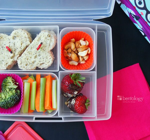 Kids' Bento Box Sweet Treat Lunch features tuna sandwich, cashews, veggies, and chocolate dipped strawberries they made themselves