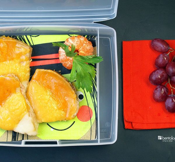 Candy Corn Quesadillas in a bento box lunch with clementine or tangerine pumpkins, celery stalks, and grapes for dessert, super yummy