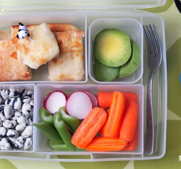 Kids Bento Box Lunch with Pizza Leftovers, veggies, avocado, and edamame protein snack, lunch bag, fork, napkins