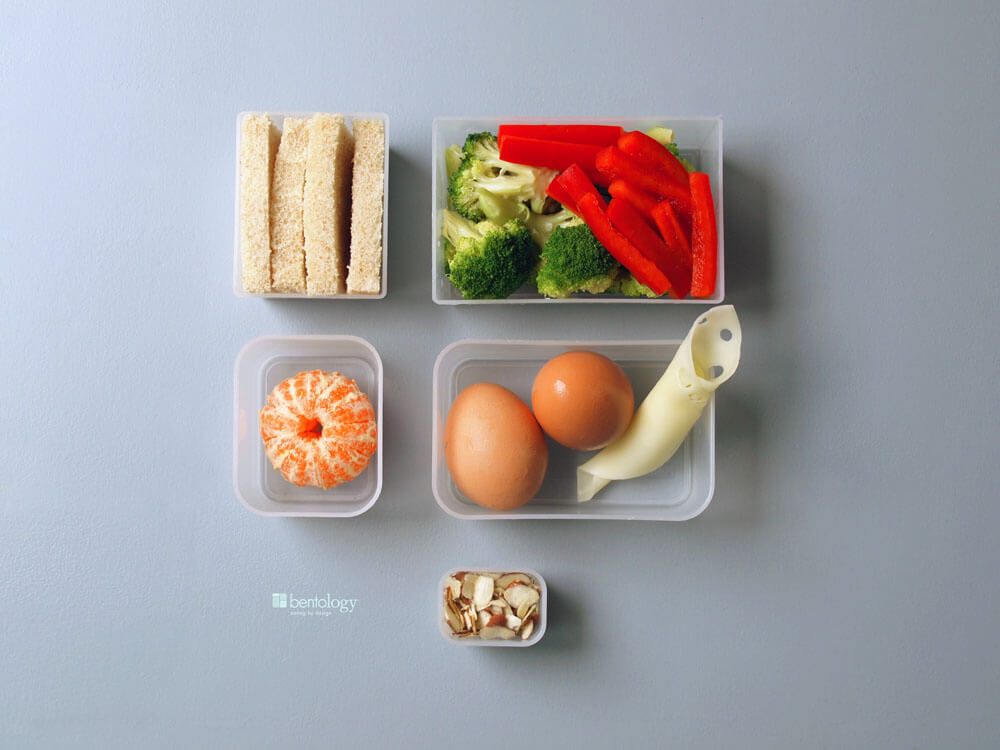 portion-perfect-omelet-with-veggies-cheese-whole-wheat-toast-and-an-orange-in-bento-box-containers