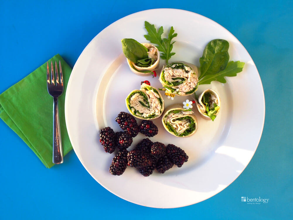Portion Perfect pinwheels with chicken, spinach, avocado, tortilla, and blackberries for dessert plate