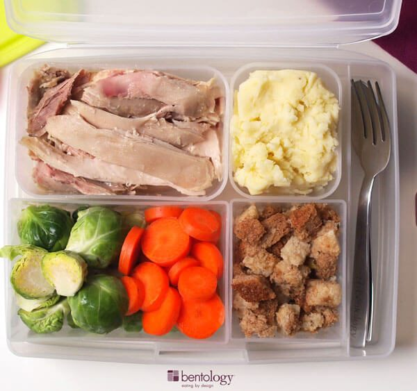 Portioning your Holiday Turkey Meal with dressing, potatoes, carrots, brussels sprouts, and cranberry sauce in your perfect portions, use your bento box lunch set, plate