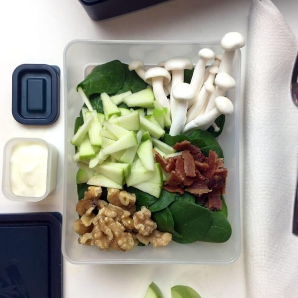 Bento Box Lunch of Spinach Salad with mushrooms, bacon, green apple, walnuts and a yogurt dressing